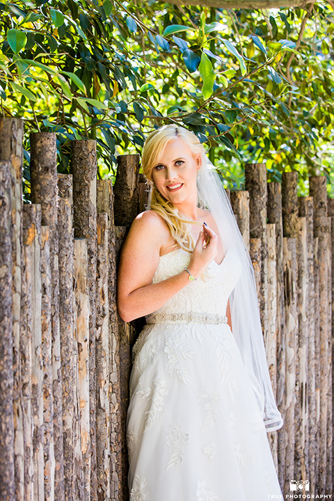 bride in a strapless white lace gown