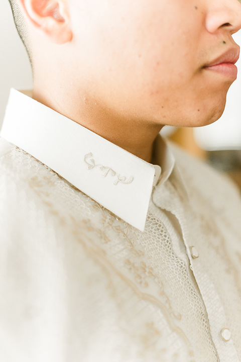 groom in an ivory cultural shirt