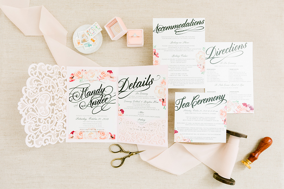 white invitations with floral decor