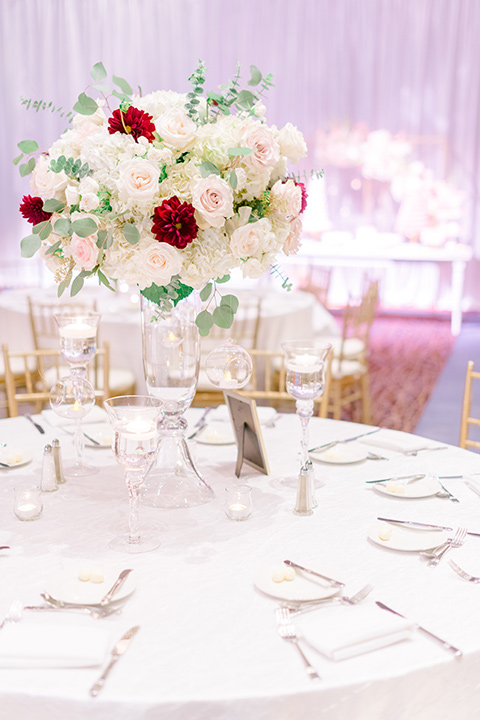 white table linens and gold flatware