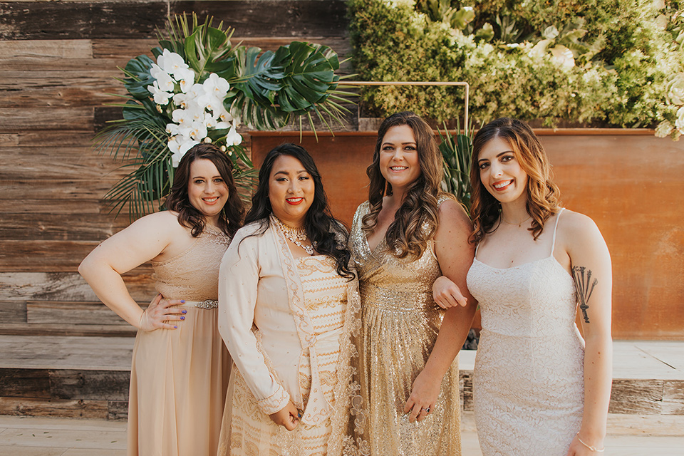 bride in a cultural Burmese gown, the bridesmaids in gold gowns