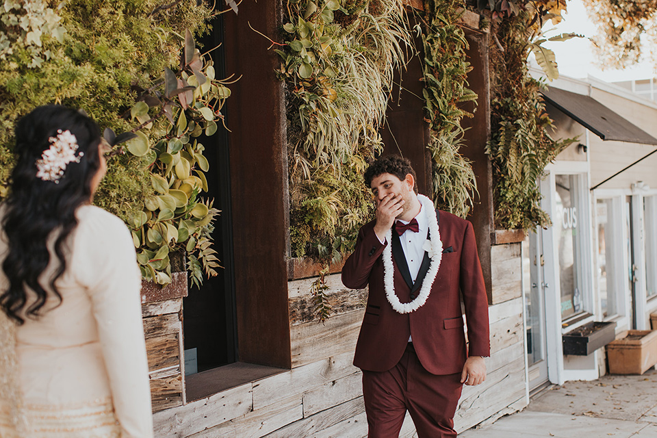bride in a cultural Burmese gown, the groom in a burgundy tuxedo with a black shawl