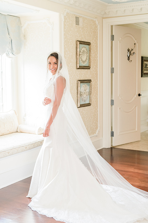 bride in a white modern lace gown with a cathedral veil