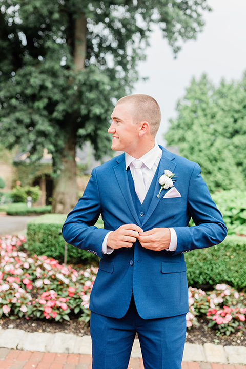 the groom in a cobalt blue suit