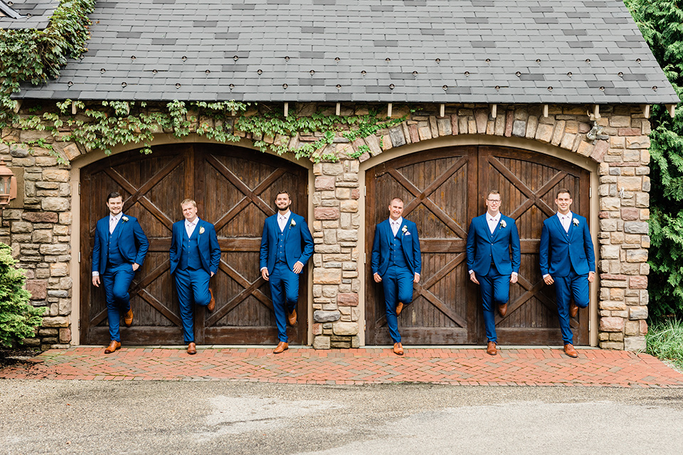 the groom in a cobalt blue suit and the groomsmen in cobalt blue suits