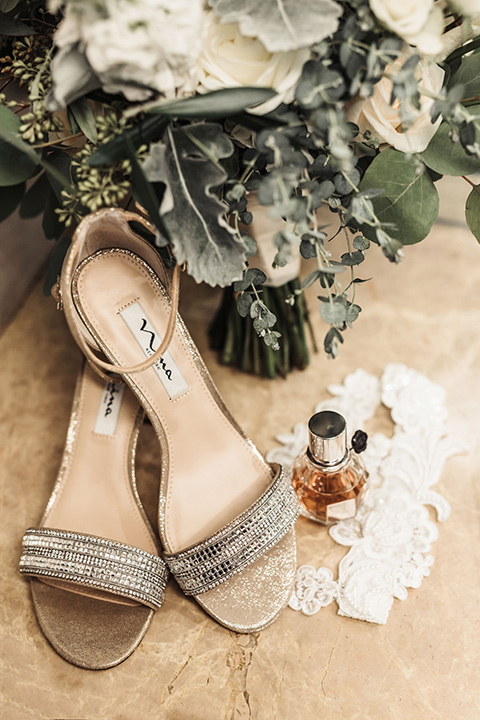bridal shoes with white flowers