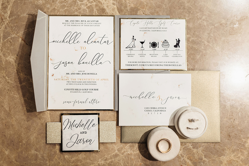 white invitations with tan and gold details