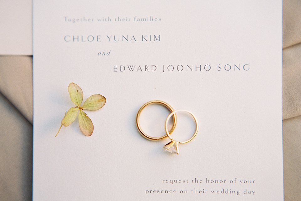 white invitations with gold simple rings