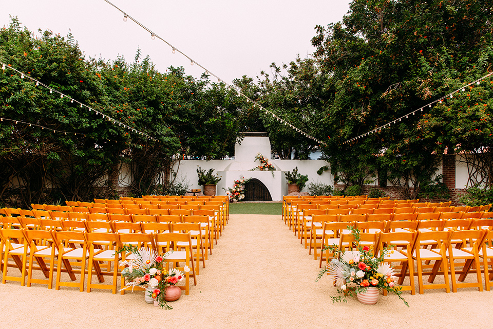 ceremony space with wooden chairs and fireplace