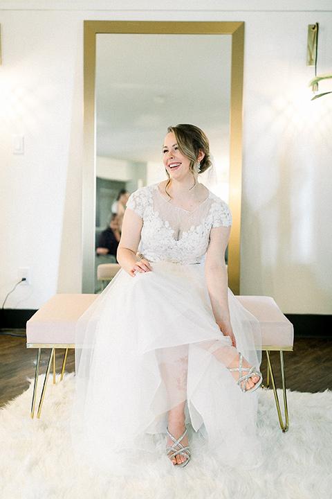 bride in a flowing gown with cap sleeves and the groom in an asphalt groom look