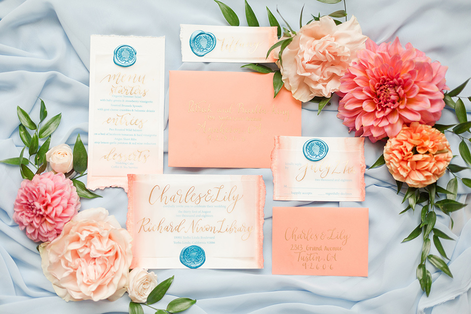 pastel colored invitations with calligraphy