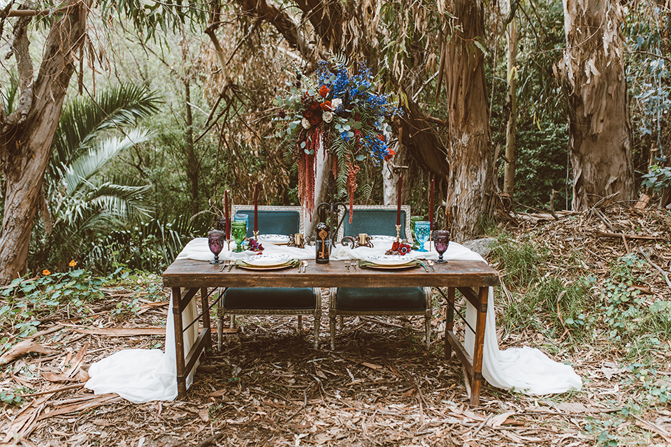 wooden tables and white flowing linens and tall candles