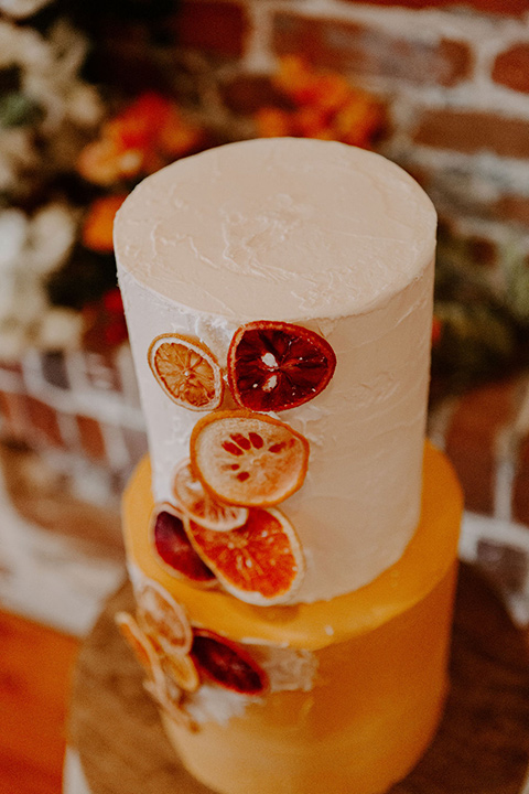 tiered cake with orange and cream detailing