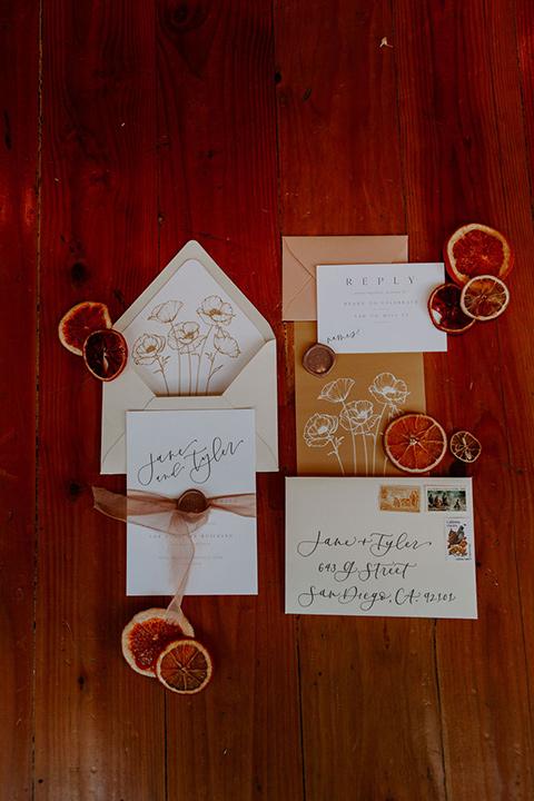 cream and burnt orange invitations