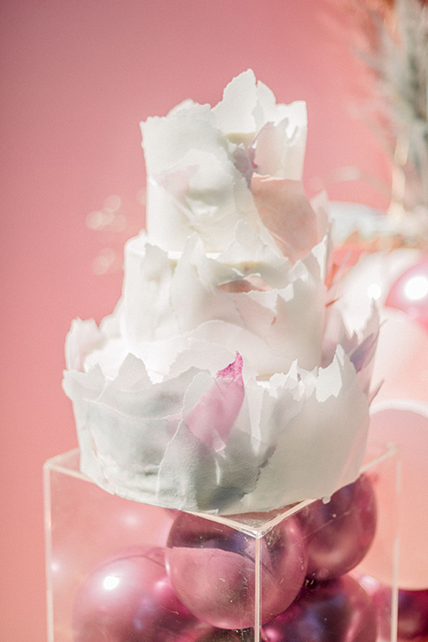 white cake with pink floral decor