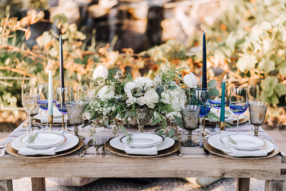 rustic table décor with candles and white flatware