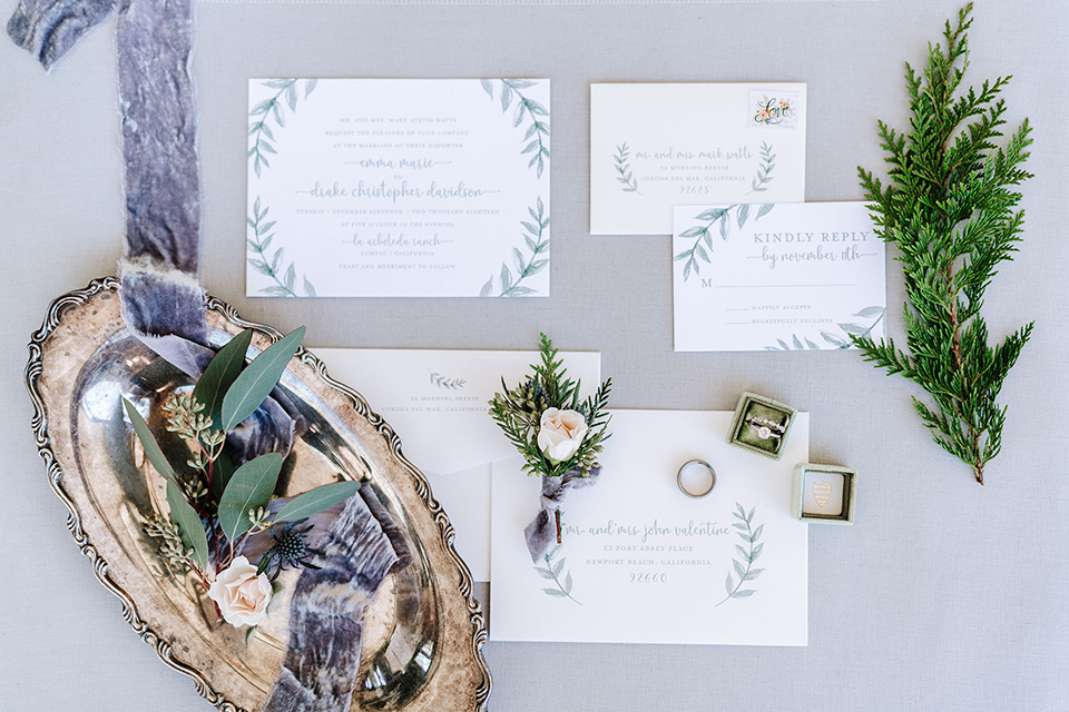 white invitations with purple and blue details