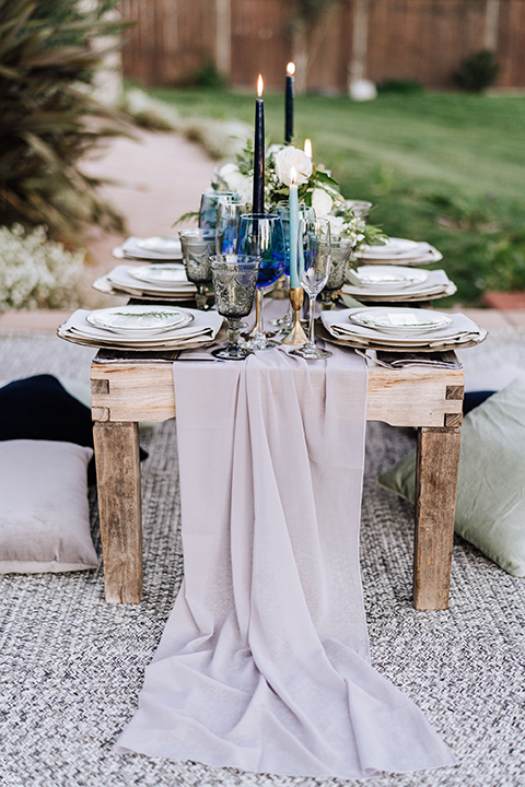 close up on white flowing linens on the table decor
