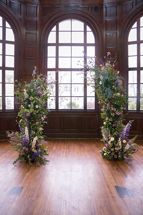 ceremony archway with purple and green flowers