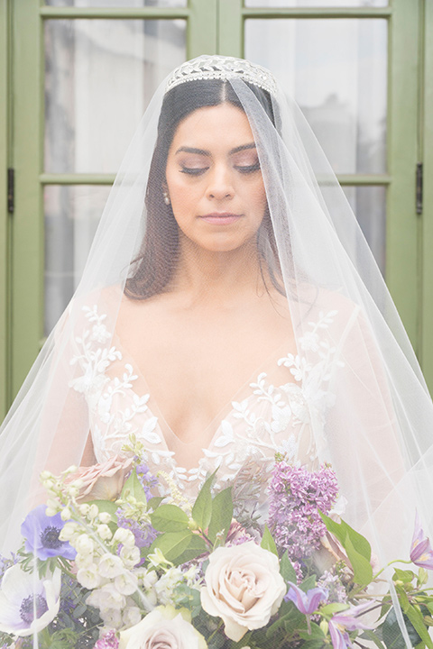 bride in a white lace ballgown with a sweetheart neckline and a regal looking crown
