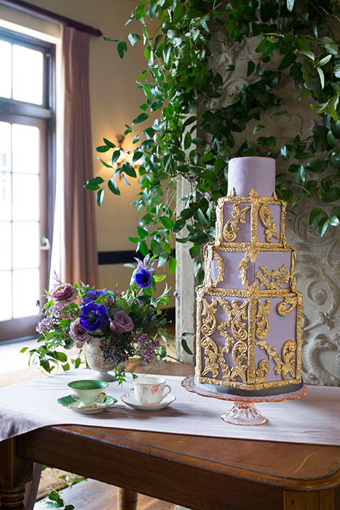 purple cake with gold detailing on a table