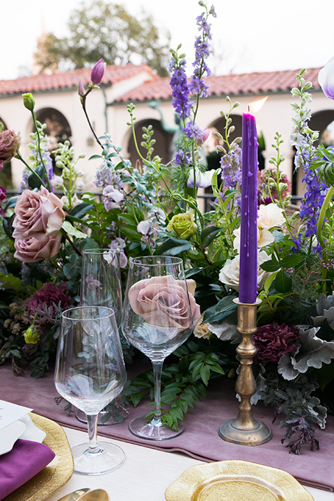 purple tall candles with green florals on the table