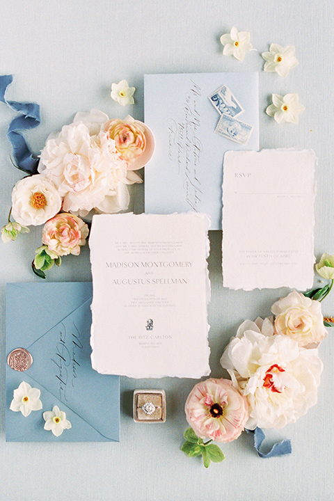 light blue invitations with flowers