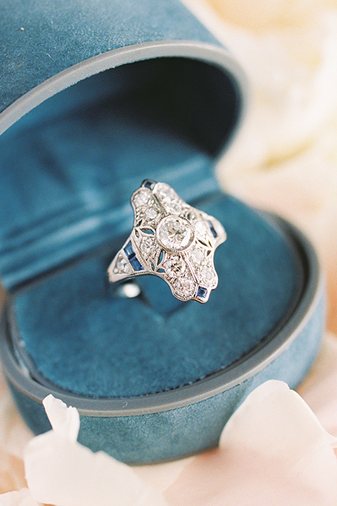 blue ring box with diamond