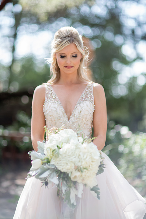 bride in a white ballgown with a deep-v neckline and crystal embellishments