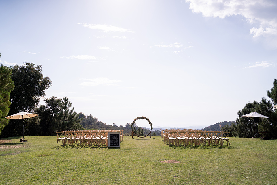 ceremony space with a circular arch and long benches