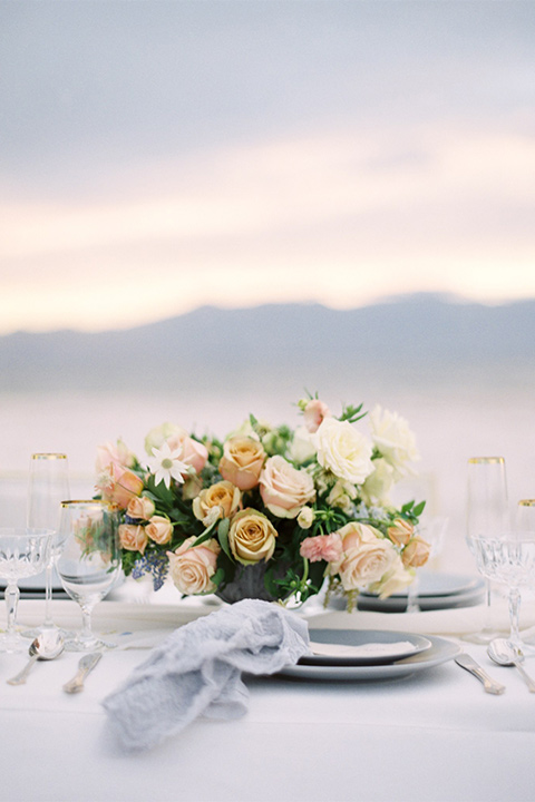 white table linens with sunset colored florals
