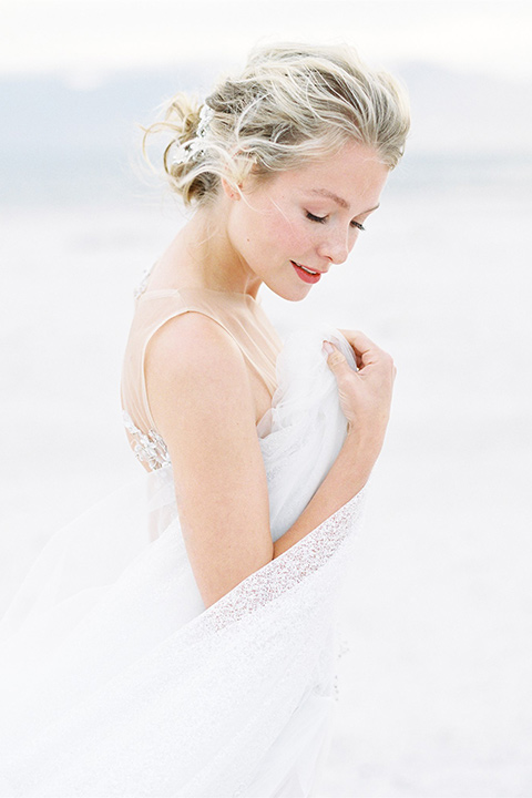 bride in a white ethereal gown with a flowing tulle train and illusion neckline