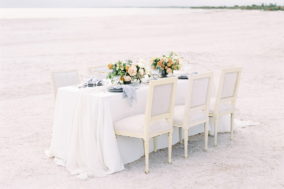 white table and table linens with sunset flowers