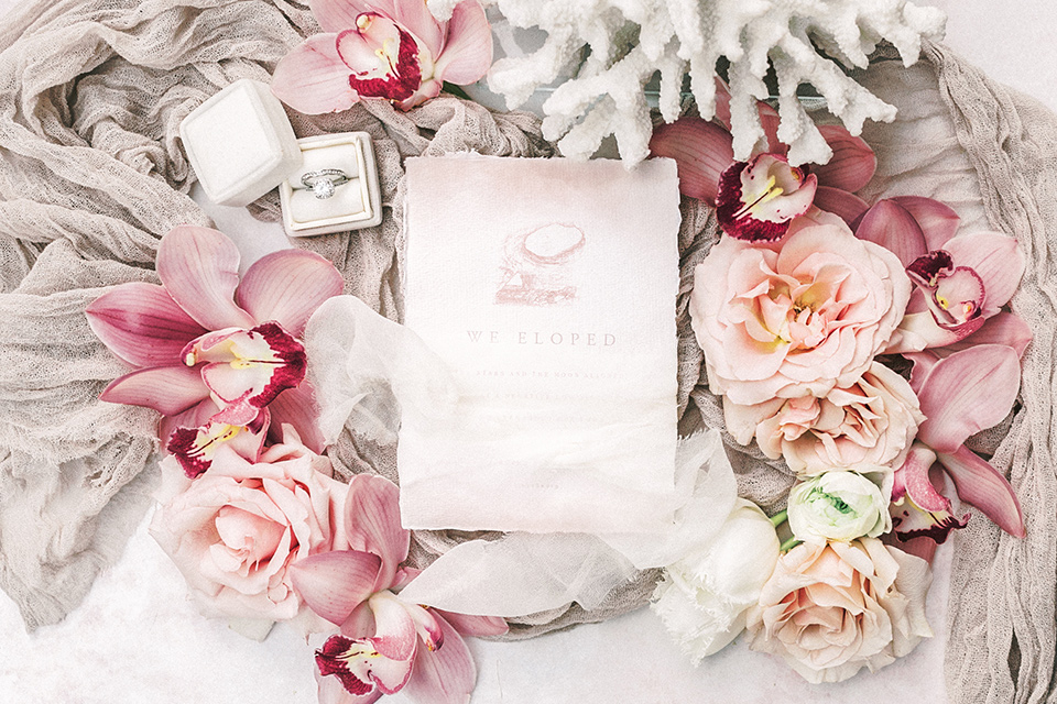 white and pink invitations