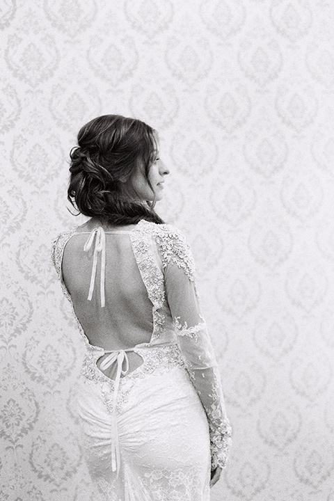 bride in a form fitting gown with an illusion back and neckline