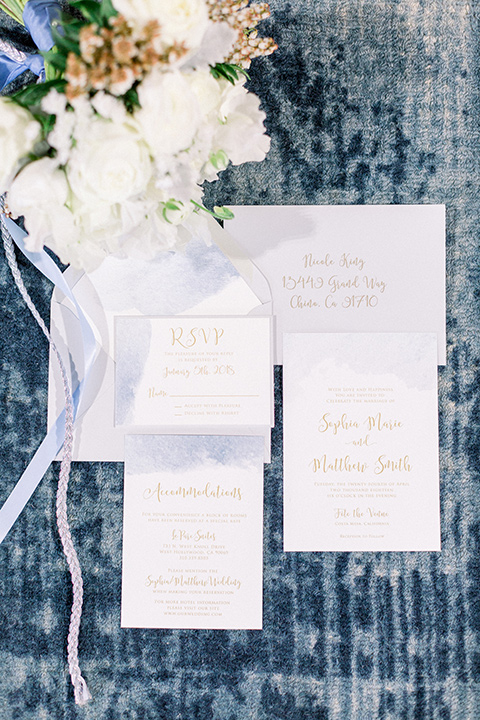white invitaions with blue calligraphy