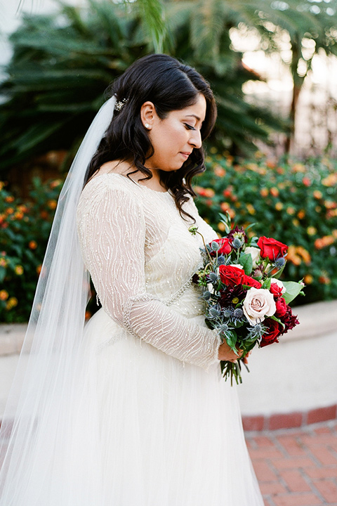bride in an ivory ballgown with gold trim