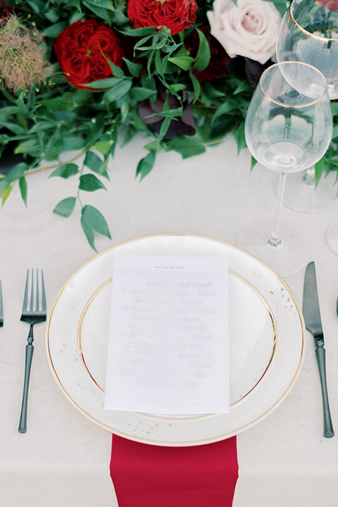 white plates and red linens