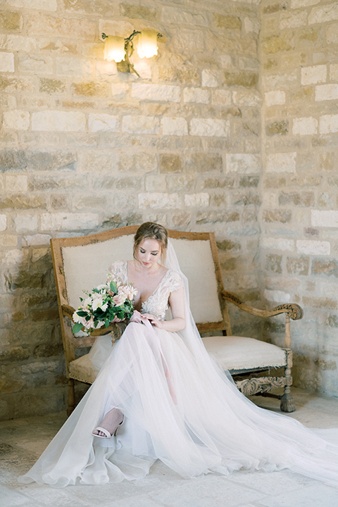 bride in a white long ball gown with tulle train and long cathedral veil