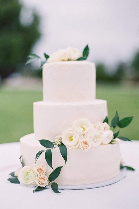white tiered cake with white floral decor