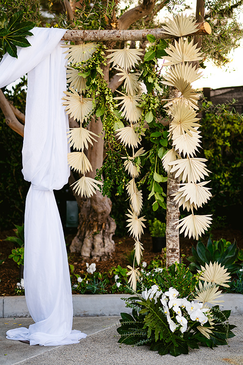 white linen detail on ceremony arch