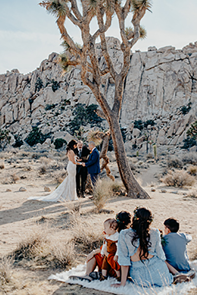 bride and groom and their vow renewal in the desert