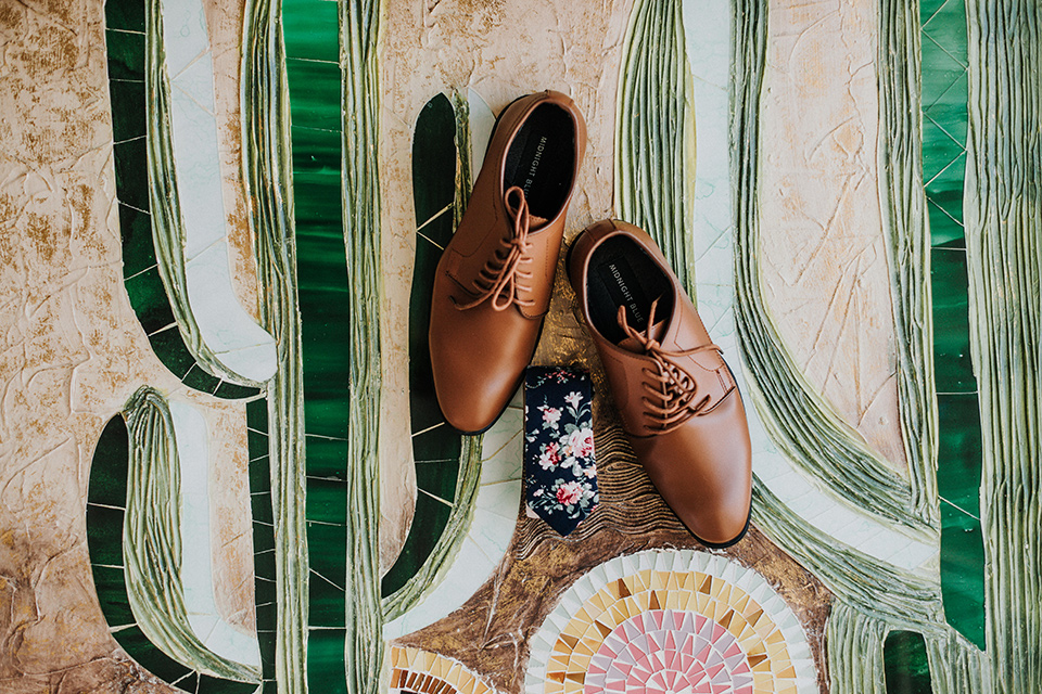 brown shoes on a fun tile decor