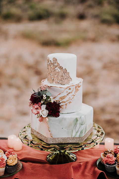 white cake with pink and red florals