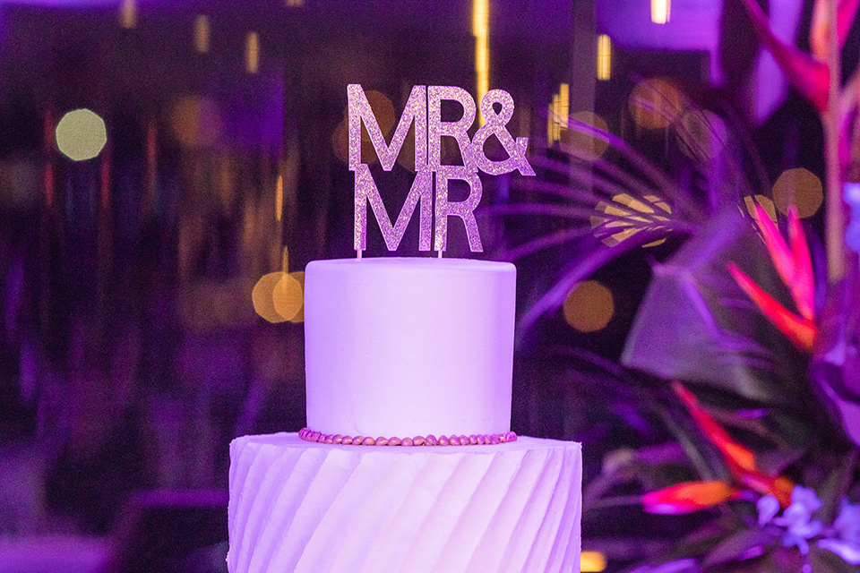 white tiered cake with a mr and mr cake topper