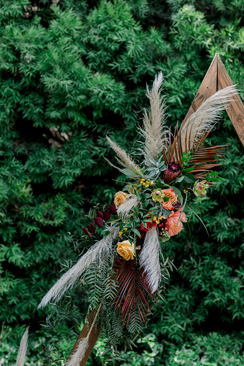 geometric wood arch with pampas grass