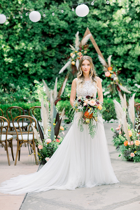 bride in a lace formfitting gown with a high neckline