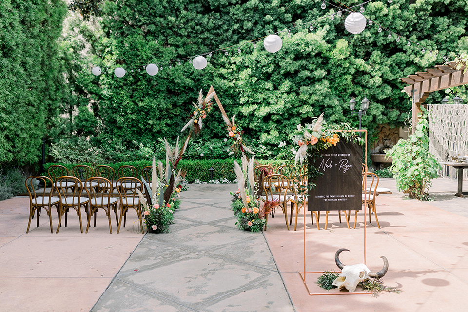 ceremony space with arch and chairs