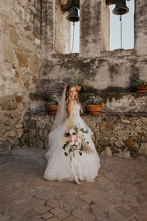 bride in a white ballgown and a lace bodice detailing