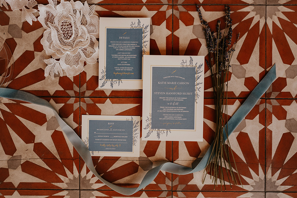 white and slate blue invitations and white calligraphy